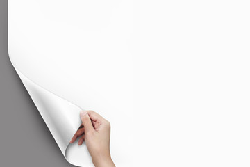 Close up of women hand turning the blank page with copy space gray background.