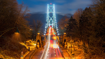 Lions Gate Bridge, North Vancouver, British Columbia - Canada. Long exposure of the bridge on a foggy night. Wall mural