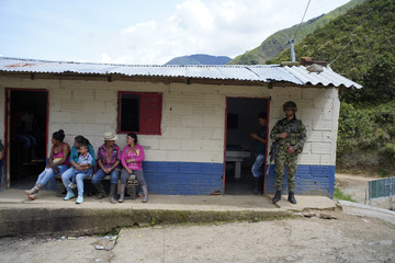 Soldier stands guard outside of a polling station as residents vote in the second round of the presidential election in La Granja, Colombia