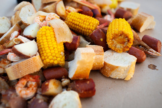 Freshly Cooked Southern Boil with Shrimp, Corn, Sausage, Potato, Onion, and Bread