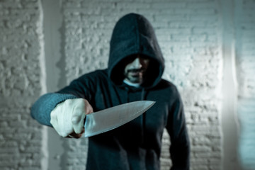 close up of man holding knife in knife crime concept photo