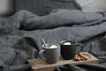 Two coffee mug in dark grey bed