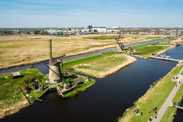 Aerial view of Netherlands rural landscape with windmills at fam