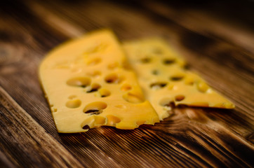 Sliced cheese on wooden table. Selective focus