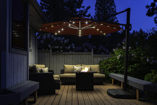 Backyard Deck Umbrella Summer Scene at Twilight
