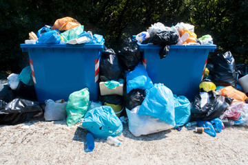 Overflowing Waste Collection Bins Outdoors