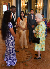 Britain's Queen Elizabeth meets some of Queen's Young Leaders at a Buckingham Palace reception following the final Queen's Young Leaders Awards Ceremony, in London