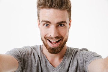 Portrait of an excited young bearded man