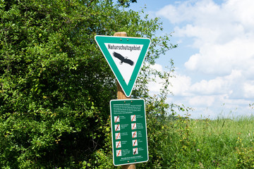 Nature reserve with a ban on board sign