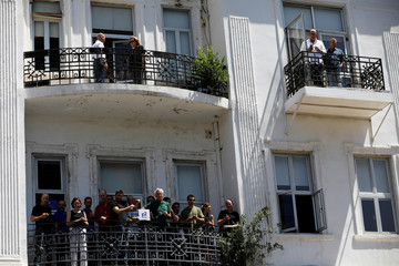 People stand on balconies watching Britain's Prince William's tour of Rothschild Boulevard, in Tel Aviv, Israel