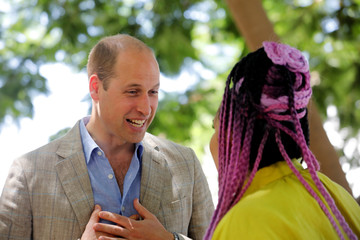 Britain's Prince William speaks with Israeli 2018 Eurovision song contest winner Netta Barzilai during a tour of Rothschild Boulevard, in Tel Aviv, Israel