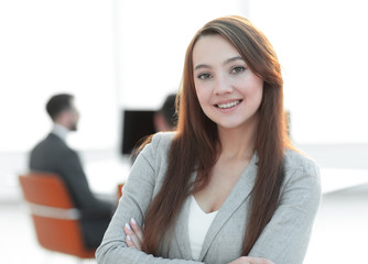 business woman on blurred background office
