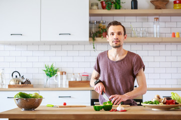 Photo of man cooking vegetables on table