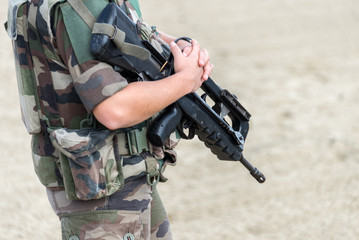 Close up of a French soldier with an automatic riffle, war and emergency state concept