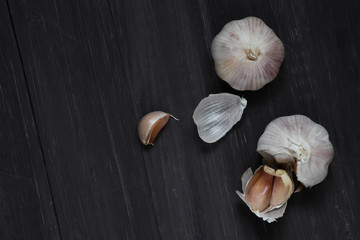 Top view of garlic on the old gray wood floor. thai food. Background layout with free text space.