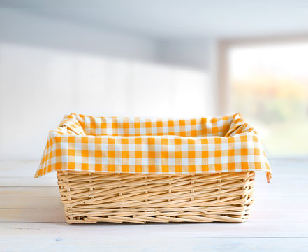 Straw basket at kitchen table empty space.