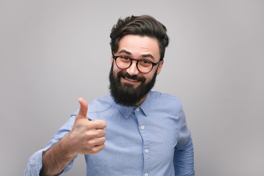 Man showing approval sign at camera