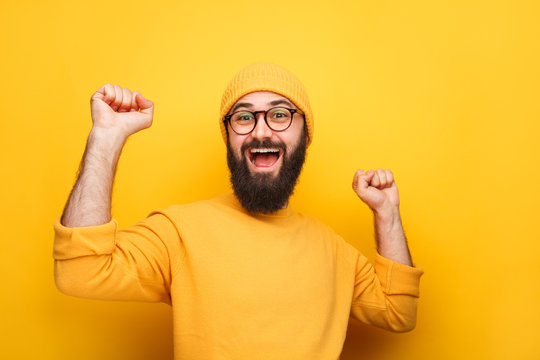 Cheerful colorful hipster with beard