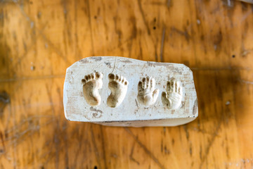 Clay imprints of feet and hands