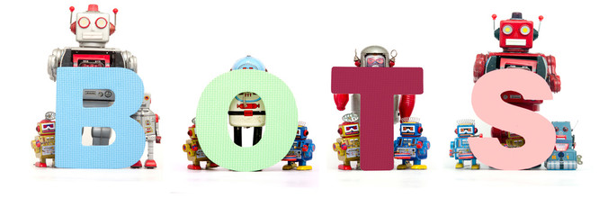 retro tin robot toys hold up the word  BOTS
