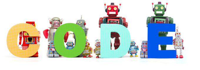 retro tin robot toys hold up the word CODE