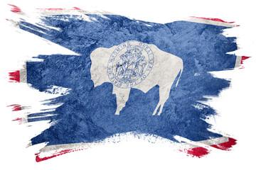 Grunge Wyoming state flag. Wyoming flag brush stroke.