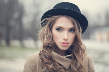 Young hipster woman outdoors. Healthy female face closeup