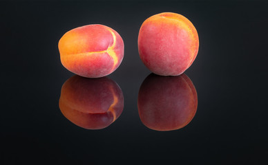 Two Apricots On A Black Background 1