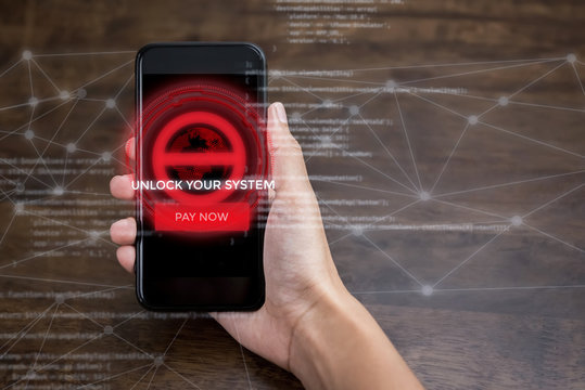 Smartphone system being locked by ransomware cyber attack