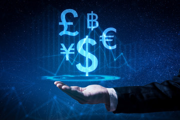 The abstract image of the business man hold the virtual hologram on hand. The concept of currency, financial, online, businessman, information technology and internet of things.