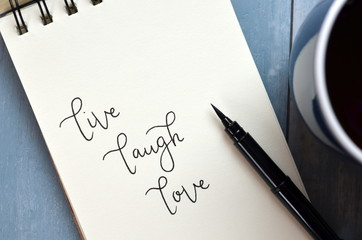 LIVE LAUGH LOVE hand-lettered in notepad