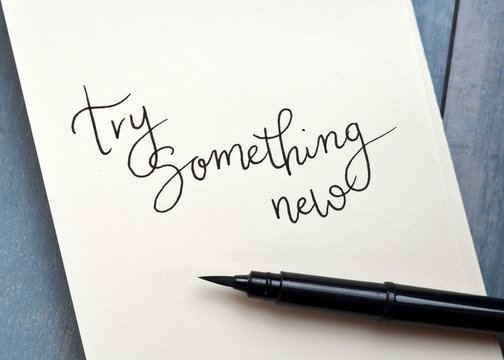 TRY SOMETHING NEW hand-lettered in notepad