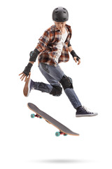 Teenage skater boy with protective equipment jumping