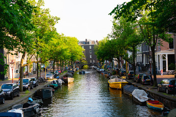 The center of a canal in Amsterdam with boats in cars
