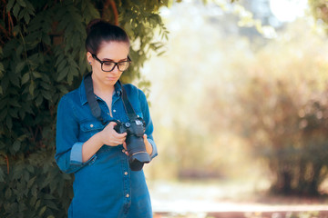 Female Photographer with DSLR Camera in the Park
