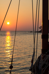 Sailing boat mast in the sunset in the Andaman sea in Thailand