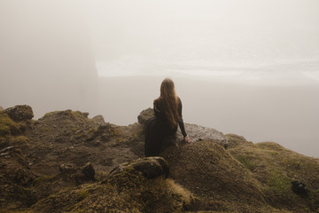 Woman in black dress in the fog in iceland