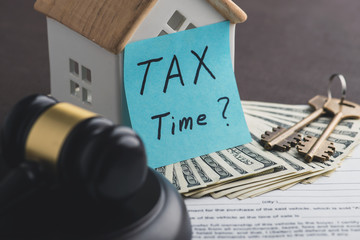 To pay real estate tax concept. Bill of Sale, money, keys and st