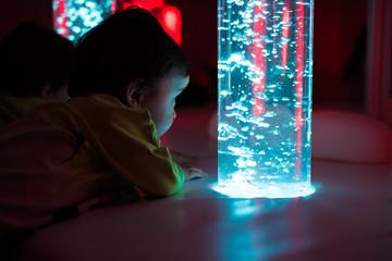 Young kid exploring snoezelen space