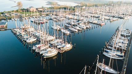 Aerial view of modern big luxury yachts in the sea port in franc