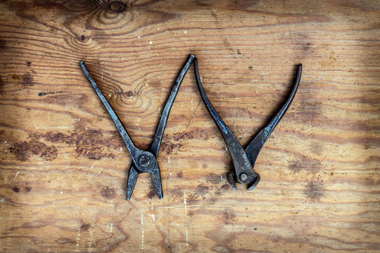 Letter with old tools on a wooden background