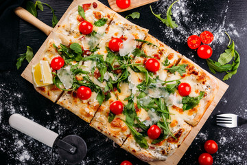 Bright pizza with cheese and vegetables