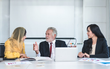 Mature Advisor Businessman Consulting with Team Businesswoman in an Office - Corporate Concept
