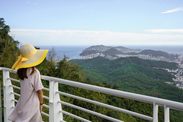 Woman on viewpoint exploring amazing landscape
