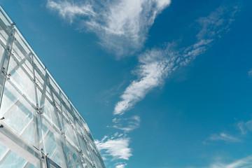 Glass slope roof under blue sky