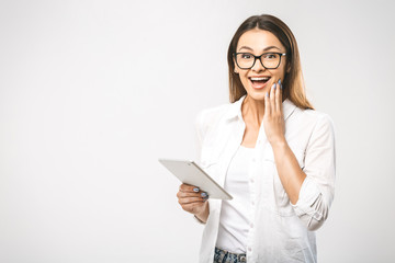 Wow! Great news! Portrait with copy space empty place of pretty charming confident trendy woman in classic shirt having tablet in hands isolated on white background