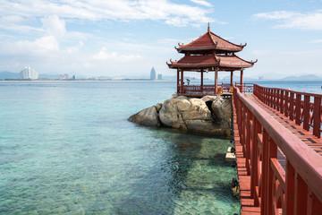 Ornamental footbridge on tropical seaside