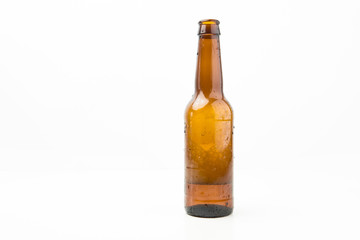 Ice Cold Wet Condensated Lager Beer Bottle With Beer And Foam Inside Isolated On White Background