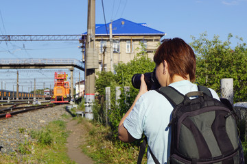 girl takes pictures of the railway station