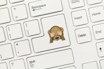 White conceptual keyboard - Key with Monkey covering eyes Emoji symbol